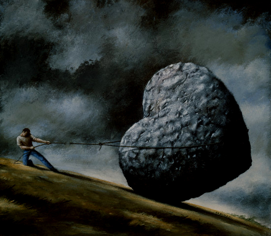 Rope Breaking on Man Holding Stone Heart on Hillside
