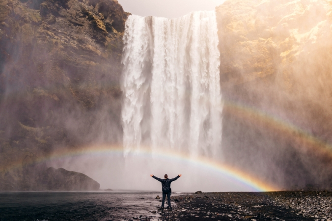 main-standing-beneath-the-waterfall-and-double-rainbow